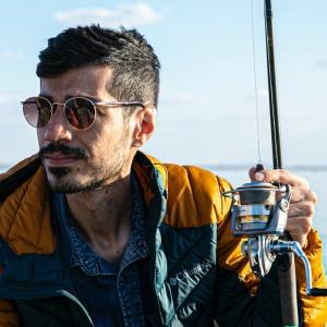 photo-of-man-holding-fishing-rod-2917276
